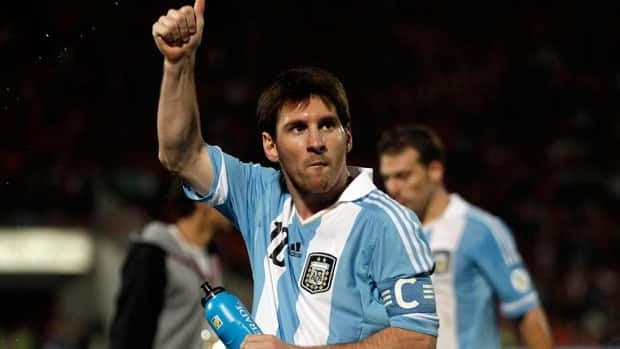 Argentina's Lionel Messi gestures to fans at the end of a World Cup qualifying soccer match against in Santiago.