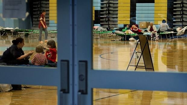 Families are seen through the door leading to the gymnasium of Cape Henlopen High School which was used as a Red Cross shelter in Lewes, Delaware during Hurricane Sandy.