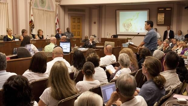 The Stockton city council listens to statements from citizens on Tuesday. Local politicians eventually approved a special bankruptcy budget.