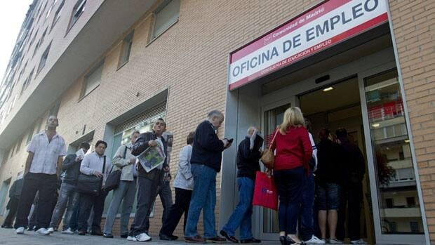 People register as unemployed at an office in Madrid Tuesday. The number of jobless in Spain is now up to 4.71 million.