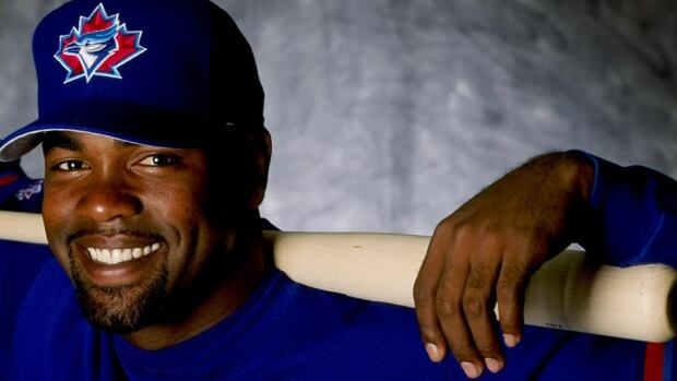 Former Blue Jays slugger Carlos Delgado, seen here posing for a photo in his early years with the team, will be inducted into the club's Level of Excellence on Sunday.