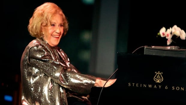 Marian McPartland smiles while playing the piano during a celebration of her 90th birthday in New York on March 19, 2008.