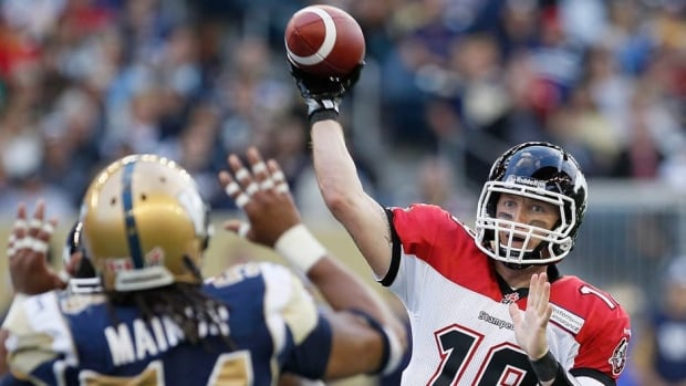 Calgary Stampeders' Bo Levi Mitchell (19) throws against Winnipeg Blue Bombers' Kenny Mainor (54) during the first half Friday.