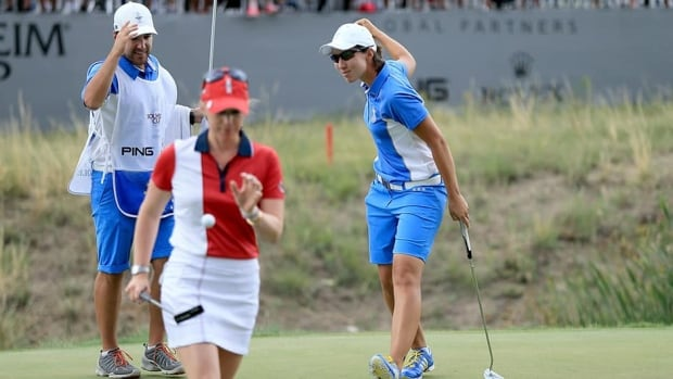 Carlota Ciganda of Spain and The European Team celebrates her win against Morgan Pressel of the USA by 4 and 2 in the final day singles matches in the 2013 Solheim Cup at The Colorado Golf Club on Sunday in Parker, Colorado.