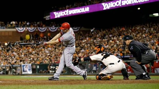 Cincinnati Reds' Jay Bruce hits a two run double in the eighth inning during Game 2 of the National League division series Sunday against the San Francisco Giants.