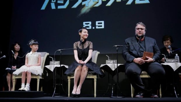 Mexican film director Guillermo Del Toro, right, speaks as Japanese actresses Mana Ashida, left, and Rinko Kikuchi listen during a press conference to promote Pacific Rim in Tokyo on Sunday.