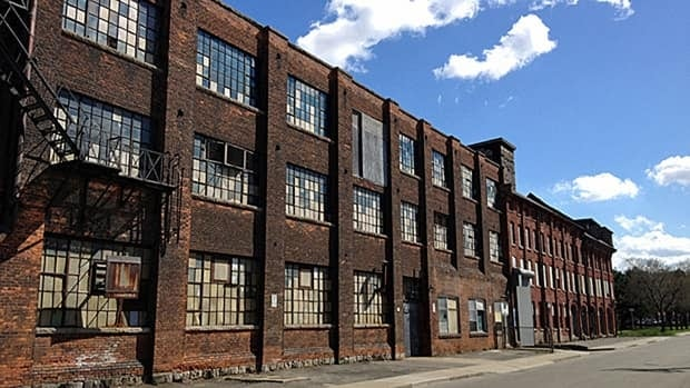 After 10 years and still no anchor tenants, the Cannon Knitting Mills are up for sale again. The city says the last decade of effort wasn't a failure, but others disagree. (Sheryl Nadler)