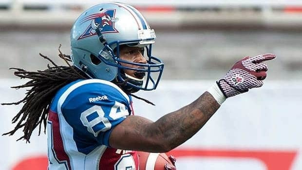Montreal Alouettes' Trent Guy celebrates after scoring a touchdown against the Toronto Argonauts during first half CFL football in Montreal on Sunday.