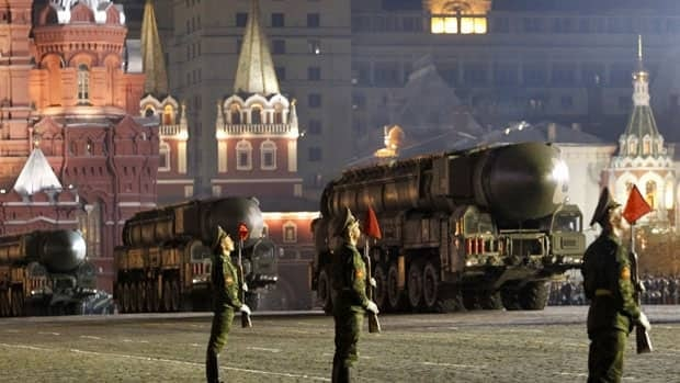 Mobile missile launchers drive along Red Square during a military parade rehearsal in Moscow. The Russian military warned Thursday of a pre-emptive strike against U.S.-led NATO missile defence facilities if plans for a missile shield proceed.