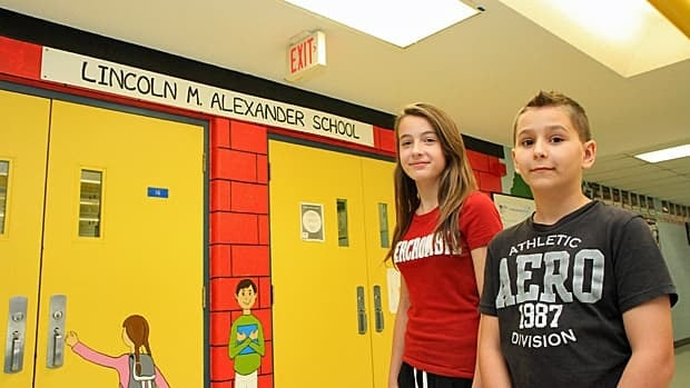 Nicole Constantini and Jacob Keogh, students at Lincoln Alexander School, have great respect for their school's namesake. (Samantha Craggs/CBC)