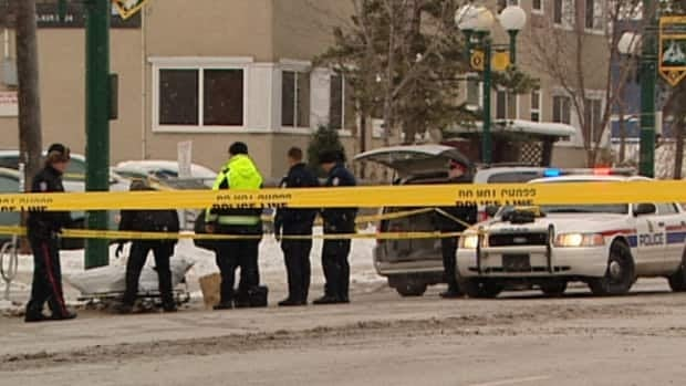 Police tape off a section of 107th Ave north of downtown after a man's body was found there early Saturday morning.