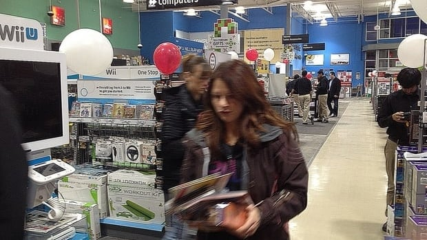 Kelly McGillivray was up early Friday morning waiting in line to find a deal on a computer in Saskatoon.
