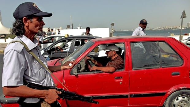 A police agent mans a checkpoint in Tripoli, the Libyan capital. Libya's Olympic Committee chief Ahmed Nabil al-Taher al-Alam was kidnapped Sunday by armed men on the streets of Tripoli.