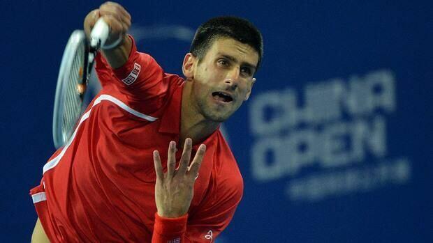 Novak Djokovic of Serbia serves before winning his quarter-final men's singles match against Jurgen Melzer of Austria at the China Open on Friday.