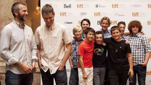 Rob Wilson, left, and Jason Lapeyre, right, are co-directors of the film I Declare War, featuring this young cast, in Toronto on Aug. 8.