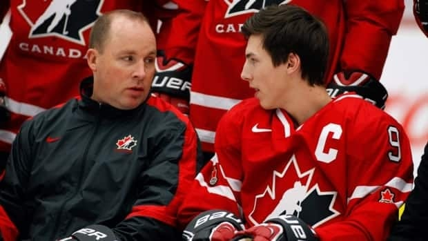 Head coach Steve Spott, left, and Ryan Nugent-Hopkins, from Burnaby, B.C., chat during a photo session in Calgary, Alta., Friday, Dec. 14, 2012.