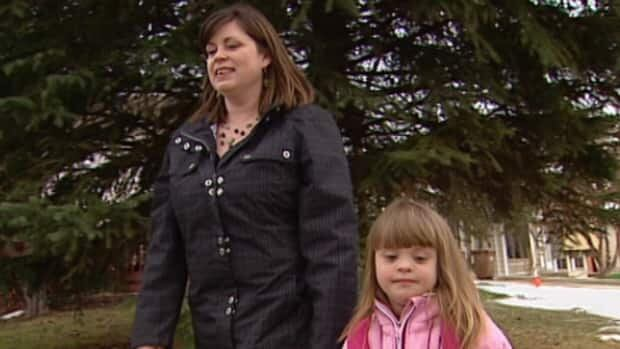 Shelley Wywal, with five-year-old daughter Elora, worries about funding changes at the Edmonton Down Syndrome Medical Clinic.
