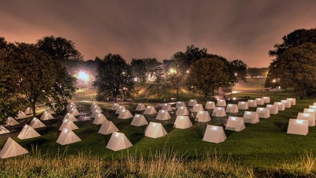 The Encampment, an art installation by Thom Sokolski and Jenny Anne McCowan, is part of this year's Luminato festival. The Ontario provincial budget reduced grants to the festival.