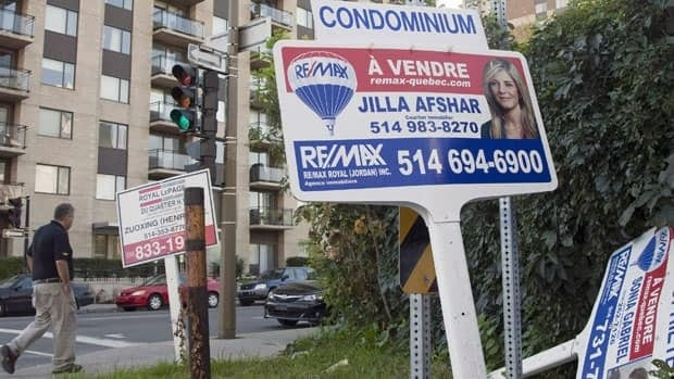 For sale signs stand in front of a condominium last year in Montreal.