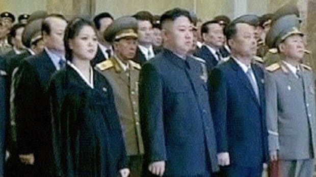 North Korean leader Kim Jong-un, second from left, is seen at the ceremony on the first anniversary of his father Kim Jong-il's death, in this still image taken from video on Dec. 17.
