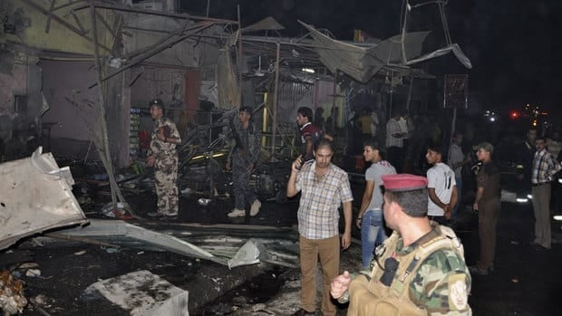 Iraqi security forces inspect the site of a car bomb attack in Nasiriyah city, 375 kilometres south of Baghdad, on Saturday. A wave of car bombings targeted Baghdad as people celebrate the end of the Muslim holy month of Ramadan, killing and wounding scores of people, officials said.