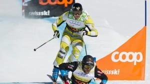 Canada's Nik Zoricic crashed directly into safety nets lining the side of the course after going wide over the final jump of the World Cup skicross event Saturday in Grindelwald, Switzerland.
