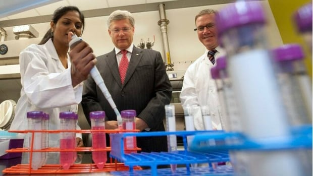 The federal government under Stephen Harper, shown here in a 2011 photo op at a Saskatoon lab, has made record investments in science and technology, said a spokeswoman for Greg Rickford, federal minister of state for science and technology. However, Statistics Canada shows federal science and tech spending is declining.