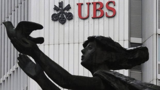 Swiss bank UBS  in Zurich announced second-quarter earnings of $734 million US and agreed to settle a lawsuit from the U.S. federal housing authority over mortgage-backed securities.