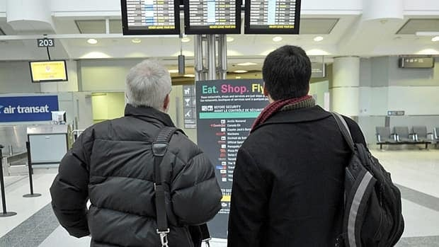 Passengers check flights at Pearson International Airport in Toronto last year. The Canada Border Services Agency has had to address privacy concerns raised by the installation of new audio-visual monitoring equipment in some airports and border areas.