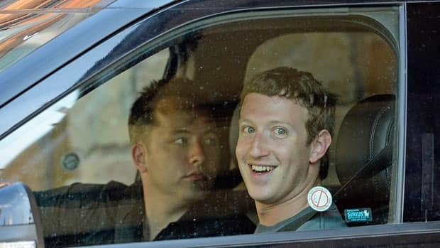 Facebook CEO Mark Zuckerberg, right, shown in July 12,says its share price drop isn't the first up and down the firm has had.