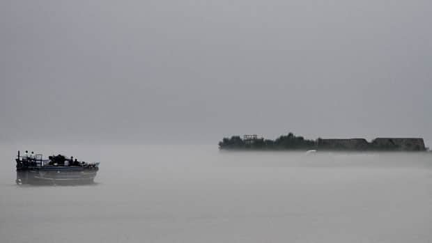 A ferry carries commuters in the river Brahmaputra at Nimati Ghat, about 312 kilometres east of Gauhati, India, on June 9, 2010.