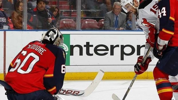Panthers goaltender Jose Theodore denies Erik Gudbranson, one of his 30 saves in a 3-0 Florida win in Game 5 on Saturday night.
