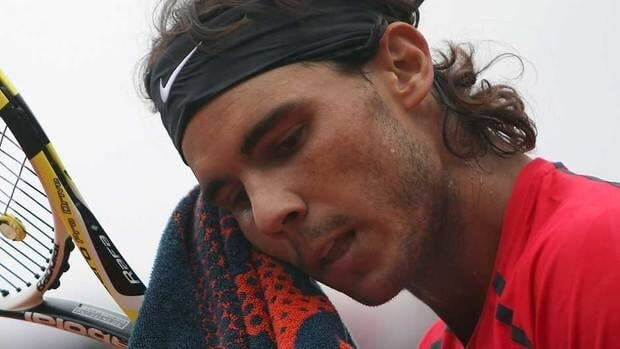 Rafael Nadal wipes his face as he plays Serbia's Novak Djokovic during their men's final match in the French Open tennis tournament at Roland Garros stadium in Paris last June. Nadal has been sidelined with a knee injury since losing in the second at Wimbledon.