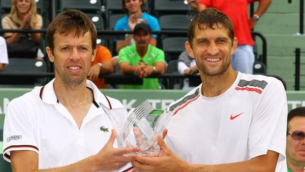 Max Mirnyi of Belarus and Daniel Nestor of Canada hold the runner up trophy at Crandon Park Tennis Center at the Sony Ericsson Open on March 31, 2012 in Key Biscayne, Florida.