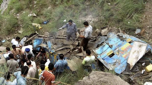 Indian rescue workers work near a wrecked bus that plunged into a deep gorge in Himachal Pradesh state, about 620 kilometers north of New Delhi, India, Saturday.