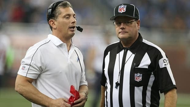 Detroit Lions head coach Jim Schwartz, left, talks with NFL official Jerry Bergman during a disputed play during the game against the Houston Texans at Ford Field on November 22, 2012 in Detroit, Michigan. The Texans defeated the Lions 34-31.