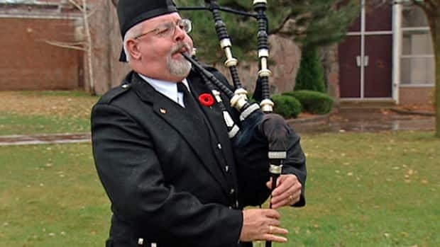 At 11 a.m. Monday, Ouellette, who learned to play bagpipes when he was nine, played Flowers of the Forest alone and in the rain, beneath the flagpole on Riverside High School's front lawn.
