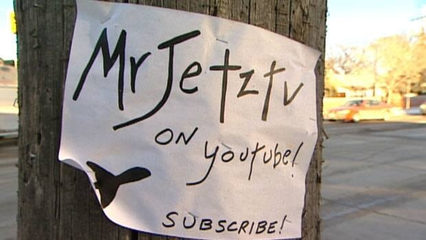 Signs promoting the MrJetztv YouTube channel have been posted on hydro poles and walls around Winnipeg in recent weeks.