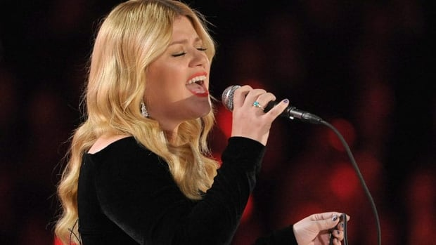Kelly Clarkson, seen performing at the Grammy Awards in February, purchased the ring and a first-edition Austen novel in 2012.