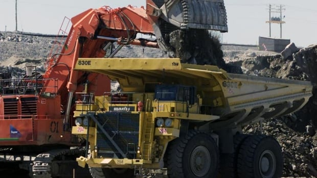 A excavator loads over burden rock into a heavy hauler at the Diavik diamond mine at Lac de Gras, approximately 300 km north east of Yellowknife.