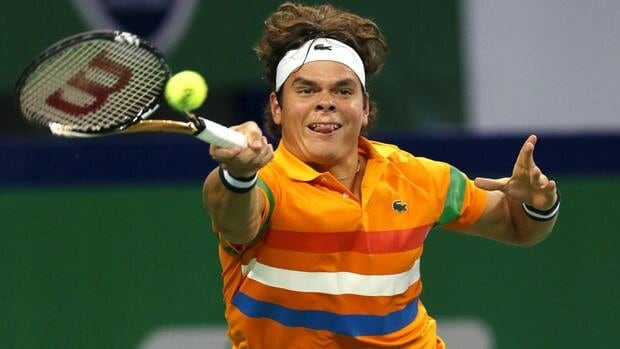 Milos Raonic of Canada returns a shot to Marinko Matosevic of Australia during the first round of the Shanghai Masters at Qizhong Forest Sports City Tennis Center in Shanghai, China on Tuesday.
