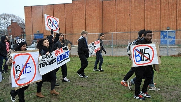 Students at Sir John A. Macdonald Secondary School in Hamilton protest the provincial Bill 115 on Monday. (Cory Ruf/CBC)