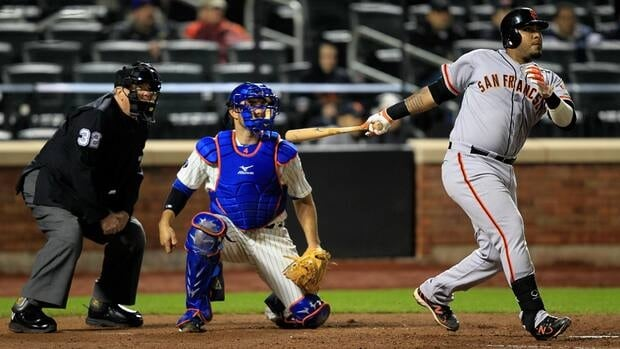 Hector Sanchez of the San Francisco Giants hits a two-run homer in the seventh inning against the New York Mets on Monday night.