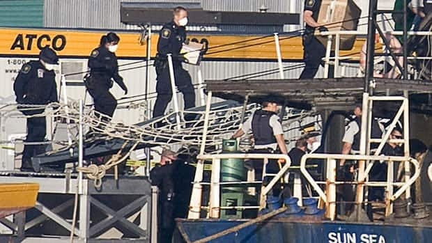 Police in British Columbia board the MV Sun Sea in 2010. Under a law passed last month some refugees who arrive on simliar ships can be deemed 'irregular arrivals' and detained for long periods.