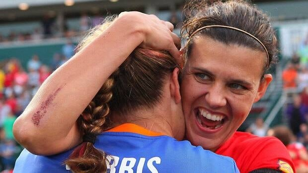 Western New York Flash's Christine Sinclair hugs goalkeeper Ashlyn Harris after their team defeated Philadelphia Independence during the WPS championship soccer game Aug. 27 in Rochester, N.Y. Women's Professional Soccer announced Monday it was suspending operations for the 2012 season.