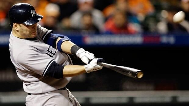 New York Yankees' Russell Martin hits a solo home run in the ninth inning of Game 1 of the American League division baseball series against the Baltimore Orioles.