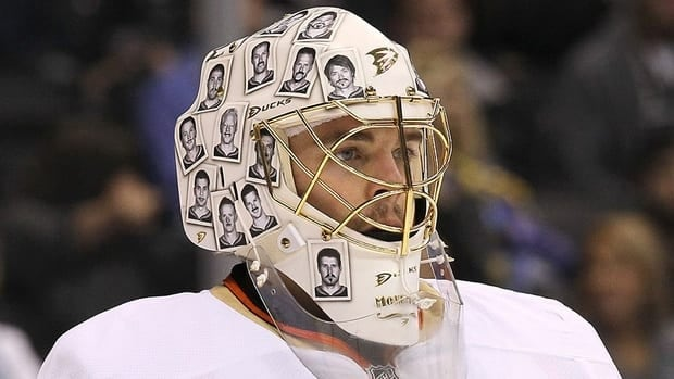 Goalie Jonas Hiller of the Anaheim Ducks wears his 'Movember' mask adorned with photos of teammates with inked on moustaches last November. Hiller has sported several different goalie masks in the past year.
