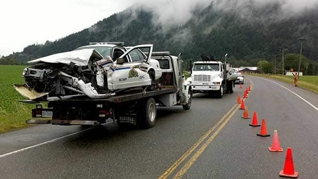 An RCMP cruiser is loaded onto a flatbed truck following a crash investigation in Agassiz, B.C., on Tuesday morning.