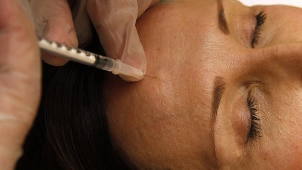 A woman in Virginia gets a Botox injection in this June 2009 photo.
