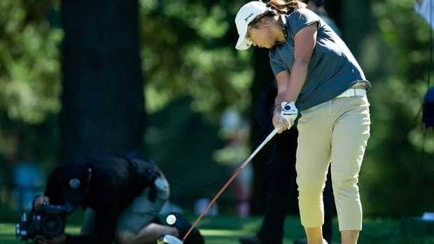 Fifteen-year-old Lydia Ko, of New Zealand, hits her tee shot on the sixth hole during the third round of the CN Canadian Women's Open at the Vancouver Golf Club in Coquitlam, B.C. on Saturday.